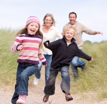 A family running in the sand dunes of Kinshaldy Beach near St Andrews, East Neuk, Northeast Fife, Scotland | Caravan Holidays Scotland | Caravan Holidays Fife | Caravan Holidays St Andrews | Caravan Holidays East Neuk | Caravan Holidays Dundee | Caravan Holidays Angus | Scottish Caravan Holidays